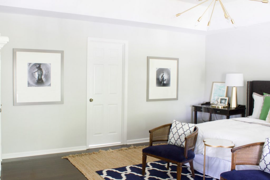 Large scale artwork was a budget DIY project. Large generic frames from a hotel liquidation outlet were transformed and black and white photos added for personalized statement pieces in this master bedroom.