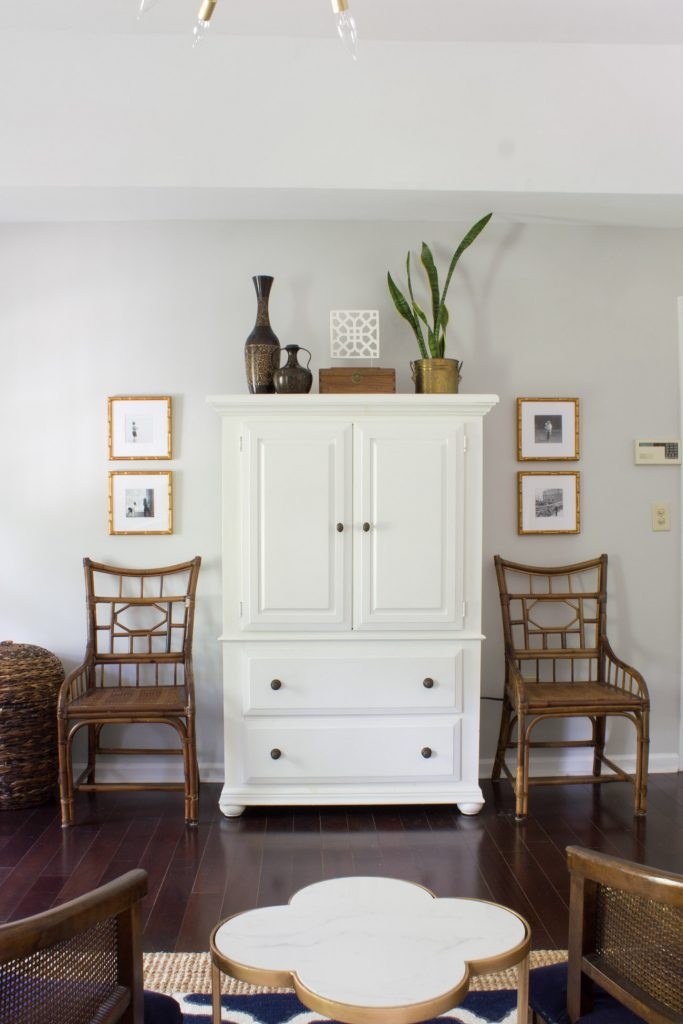 Gold Mandalay frames from Framebridge displaying Instagram photos flank this armoire in the master bedroom in this One Room Challenge makeover.