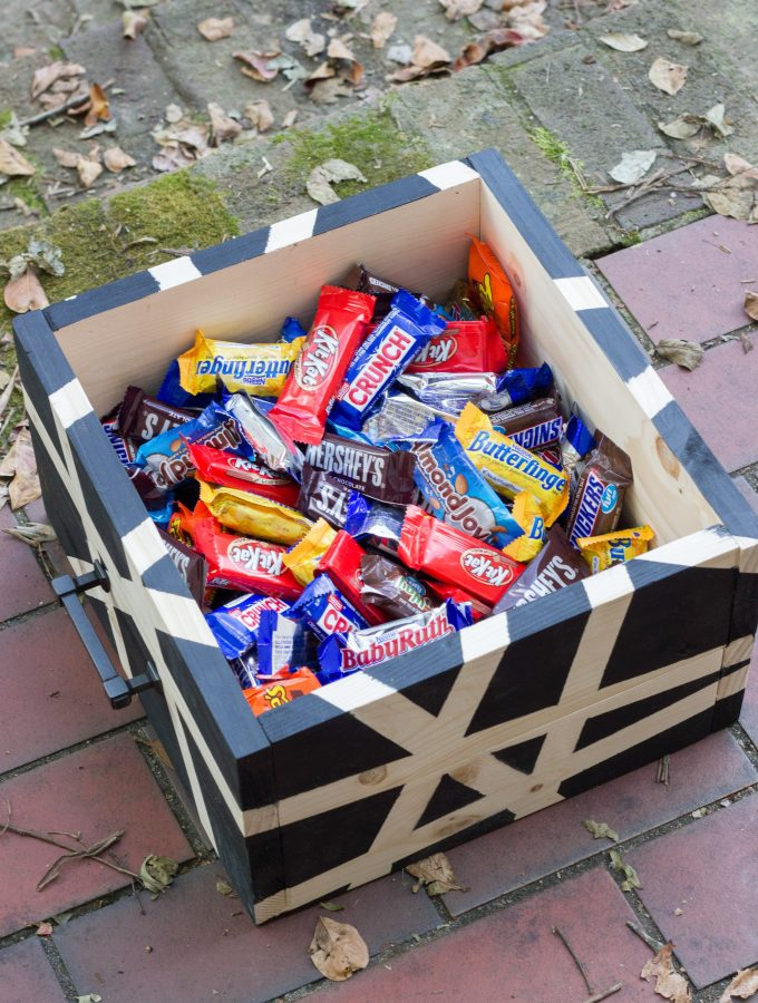 Learn how to make a DIY wooden Halloween candy bin with an abstract design!