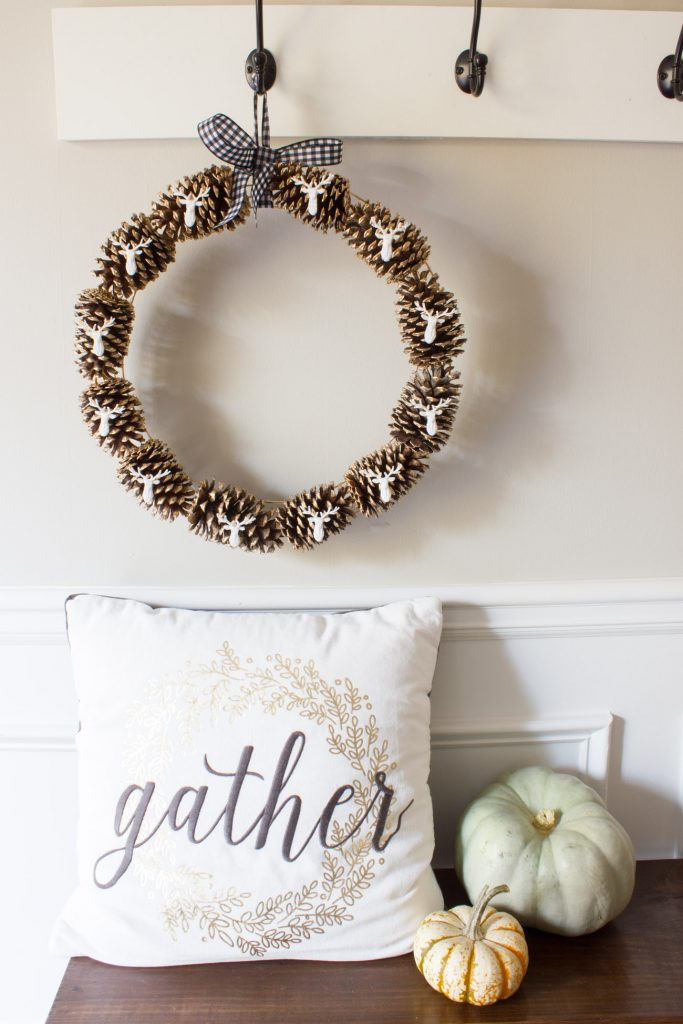 This DIY pinecone and stag head wreath is PERFECT for fall!