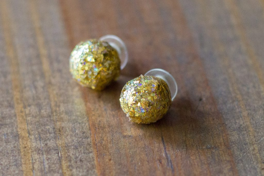 Learn how to make these DIY Glitter Ball Earrings using polymer clay and FolkArt Glitterific Acrylic Paint!
