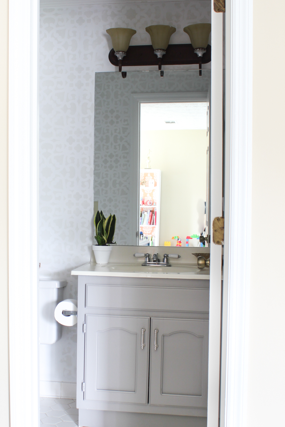 Bathroom makeover stenciled walls plus a giveaway erin spain i removed two large towel racks that kept falling down and patched the walls amipublicfo Images