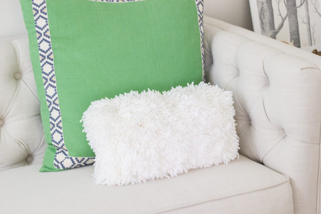 Make a DIY shag pillow using Bucilla RyaTie! It comes with a pom pom making tool which makes latch hook projects easy!