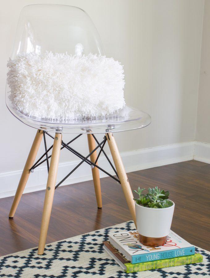 Learn to make a DIY shag pillow using Bucilla RyaTie!