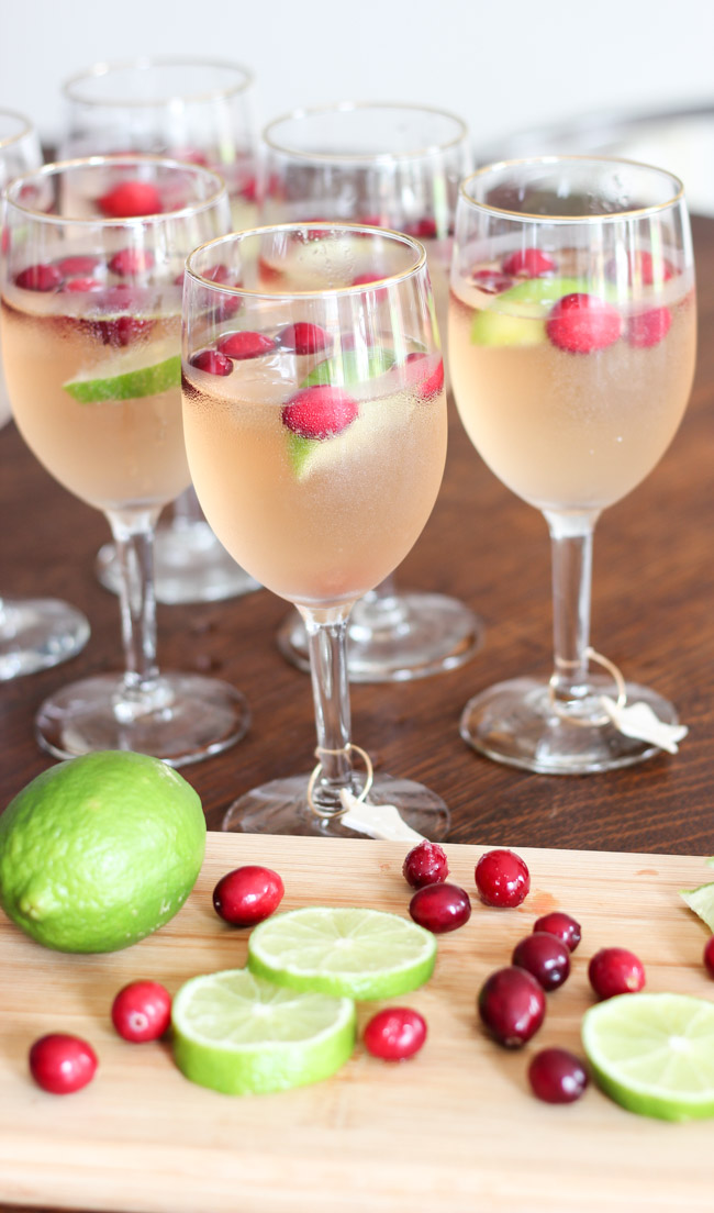 "Make these yummy Cranberry Raspberry Lime ""Mocktails"" -- perfect for the holidays! Plus, a tutorial for cute DIY monogram wine glass markers!"