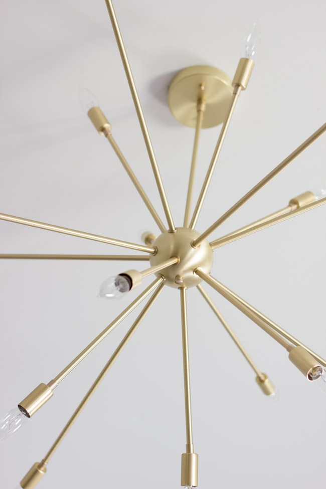This modern brass Sputnik chandelier from Lucent Lightshop is a focal point in this gorgeous master bedroom.