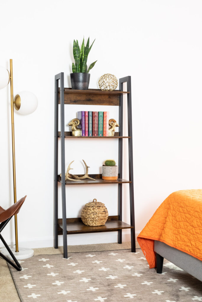 Bookshelf and floor lamp in teen boy room.