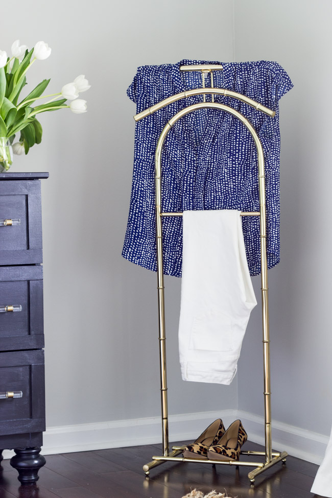 This vintage brass valet stand is the perfect spot to hang an outfit in this beautiful master bedroom.