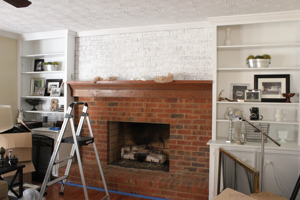 Tutorial: How to whitewash a brick fireplace.